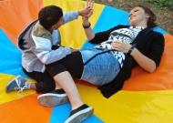 7-nidondolo-gioco-inclusivo-bambini-disabili-giostra-piano-oscillante-allenamento-sport-leura